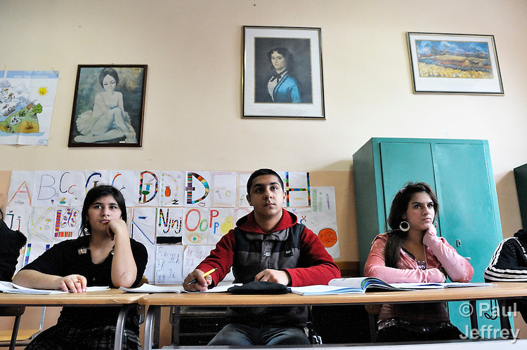 Bajram Kruezi (center) in class at the Branko Pesic School, an educational center for Roma children and families in Belgrade, Serbia, which is supported by Church World Service. Kruezi's family came to Belgrade as refugees from Kosovo, and like many Roma can't afford regular school fees. Many Roma also lack legal status in Serbia, and thus have difficulty obtaining formal employment and accessing government services.