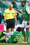 Hibs v St Johnstone....27.11.10  .Ref Christian Lautier has a laugh with Francis Dickoh at Sol Bamba's expense.Picture by Graeme Hart..Copyright Perthshire Picture Agency.Tel: 01738 623350  Mobile: 07990 594431