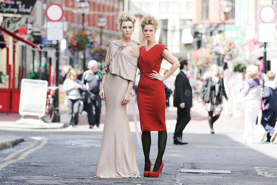 14/7/2010. Brown Thomas Autumn winter 2010. Pictured on the roof of the Brown Thomas offices in Dublin for the launch of the Brown Thomas Autumn winter 2010 collection are Models Sarah and Nikki are pictured wearing a Victoria Beckham nude Jersey evening dress EUR2495 and a Victoria Beckham rust body con dress EUR1275. Picture James Horan/Collins