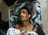 """Boday of nineteen-year-old Muhammad Al-Najjar was riddled with 13 bullets Undercover Israeli forces killed a teenage Palestinian civilian and injured four others in the southern Gaza Strip town of Khuza'a on Tuesday morning.<br /> Palestinian medical sources said .""""photo by Fady Adwan"""""""