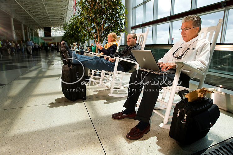 Travelers passing through Charlotte-Douglas International Airport relax on the many rocking chairs the airport has become famous for. ..Charlotte-Douglas International Airport, one of US Airways' largest hubs, serves 10 major airlines, including Air Canada, Air Tran, American, Continental, Delta, JetBlue, Lufthansa, Northwest and United. The airport is the nation?s 10th largest in terms of total operations, the 18th largest in terms of total passengers and the 37th largest in terms of cargo. Charlotte-Douglas serves 640 daily flights, including direct flights to 120 cities. ..Photographer has series of images from Charlotte-Douglas International Airport, including aerials. ... PATRICK SCHNEIDER PHOTO.COM