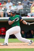 Dayan Viciedo #24 of the Charlotte Knights follows through on his swing against the Syracuse Chiefs at Knights Stadium on June 19, 2011 in Fort Mill, South Carolina.  The Knights defeated the Chiefs 10-9.    (Brian Westerholt / Four Seam Images)
