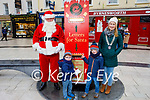 Oisin and Hugh O'Donnell ready to post a letter to Santa with Santa Claus and Sharon Hayes (President of Tralee Rotary club) as the Tralee Rotary Club launch their Santa Claus Postbox on Saturday.