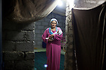 DOMIZ, IRAQ: Berivan holds her infant child in the Domiz refugee camp....Over 7,000 Syrian Kurds have fled the violence in Syria and are living in the Domiz refugee camp in the semi-autonomous region of Iraqi Kurdistan...Photo by Ali Arkady/Metrography