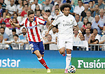 Real Madrid's Marcelo Vieira (r) and Atletico de Madrid's Saul Niguez during Supercup of Spain 1st match.August 19,2014. (ALTERPHOTOS/Acero)