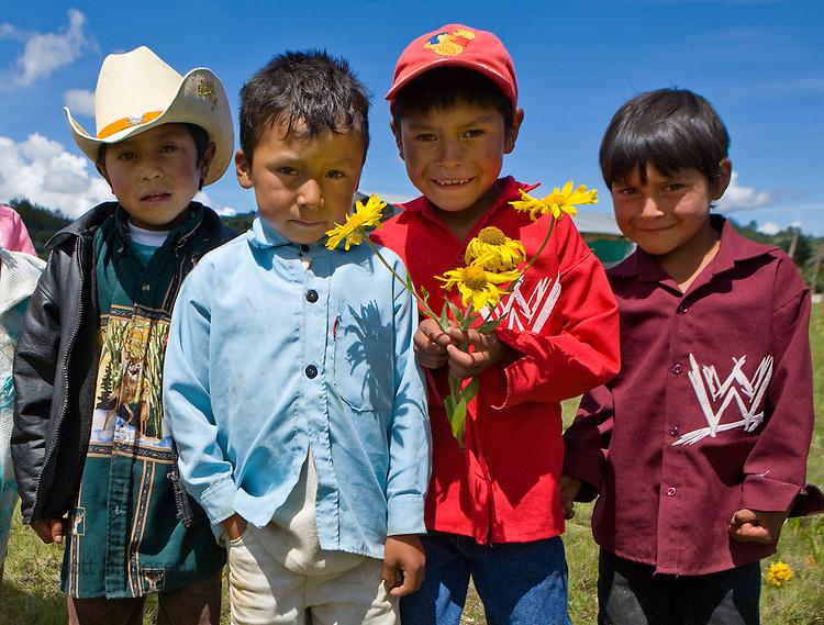 Four boys pose near a church in San Nicolas, Western Highlands, Guatemala