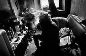 Moscow, Russia.1995.Willie is an invalid pensioner who lives in an old Stalin era collective apartment that houses 4 families. He makes $40 a month when he is paid and shares a single bathroom and kitchen with the other apartment dwellers.