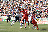 Clint Dempsey heads the ball into gaol over XuYunlong. The USA defeated China, 4-1, in an international friendly at Spartan Stadium, San Jose, CA on June 2, 2007.