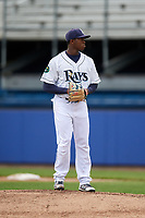 Princeton Rays starting pitcher Joe Peguero (18) gets ready to deliver a pitch during the first game of a doubleheader against the Greeneville Reds on July 25, 2018 at Hunnicutt Field in Princeton, West Virginia.  Princeton defeated Greeneville 6-4.  (Mike Janes/Four Seam Images)