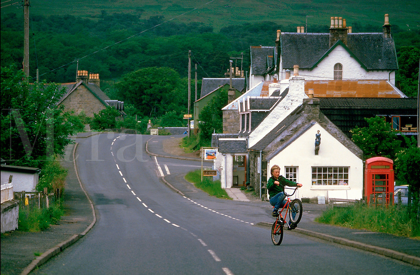 Bike-riding through village in Scotland.