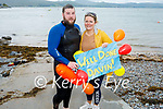 Davin Kelly get a rousing reception from Danielle Carmody after after his swim from Derrymore to Fenit on Saturday morning.