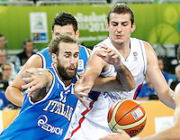 "Luigi Datome of Italt (L) and Nemanja Bjelica of Serbia in action during European basketball championship ""Eurobasket 2013""  basketball game for 7th place between Serbia and Italy in Stozice Arena in Ljubljana, Slovenia, on September 21. 2013. (credit: Pedja Milosavljevic  / thepedja@gmail.com / +381641260959)"