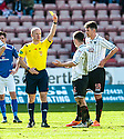 Pars' Finn Graham is yellow carded by Referee Mat Northcroft  after his late challenge on Stranraer's Willie Gibson.