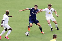 CARY, NC - AUGUST 01: Steven Miller #31 is challenged for the ball by Jonathan Dean #24 and Anderson Asiedu #6 during a game between Birmingham Legion FC and North Carolina FC at Sahlen's Stadium at WakeMed Soccer Park on August 01, 2020 in Cary, North Carolina.