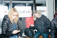 Journalists work at the back of the room as Texas senator and Republican presidential candidate Ted Cruz speaks at The Village Trestle restaurant in Goffstown, New Hampshire, on Wed., Feb. 3, 2016.