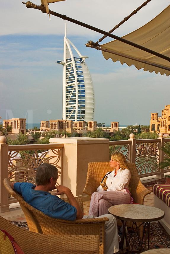Dubai, United Arab Emirates. Burj al Arab Hotel and Madinat Jumeirah. Couple (released) at Al Qasr Hotel..