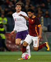 Calcio, Serie A: Roma vs Fiorentina. Roma, stadio Olimpico, 4 marzo 2016.<br /> Roma's Mohamed Salah, right, is chased by Fiorentina's Marcos Alonso during the Italian Serie A football match between Roma and Fiorentina at Rome's Olympic stadium, 4 March 2016.<br /> UPDATE IMAGES PRESS/Riccardo De Luca