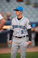 Hudson Valley Renegades manager Blake Butera (3) in a meeting with the umpires before a game against the Connecticut Tigers on August 20, 2018 at Dodd Stadium in Norwich, Connecticut.  Hudson Valley defeated Connecticut 3-1.  (Mike Janes/Four Seam Images)