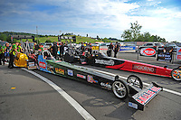 Jun. 17, 2011; Bristol, TN, USA: The cars of NHRA top fuel driver Austin Lambright (near) and Rod Fuller in the staging lanes during qualifying for the Thunder Valley Nationals at Bristol Dragway. Mandatory Credit: Mark J. Rebilas-