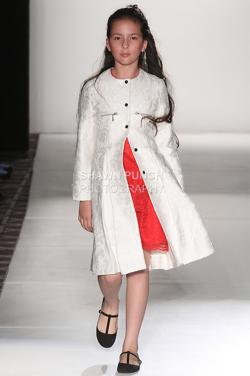 """Child model walks runway in an outfit from the Ericka Castaneda Fall Winter 2015 """"Notre Madame"""" collection, during the Emerging Designers Fall Winter 2015 fashion show for  Fashion Gallery New York Fashion Week Fall 2015."""