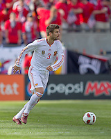 Spain defender Gerard Pique (3) dribbles. In a friendly match, Spain defeated USA, 4-0, at Gillette Stadium on June 4, 2011.
