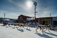Lisbet Norris runs into the chute and across the finish line in Nome on Saturday March 21, 2015 during Iditarod 2015.  <br /> <br /> (C) Jeff Schultz/SchultzPhoto.com - ALL RIGHTS RESERVED<br />  DUPLICATION  PROHIBITED  WITHOUT  PERMISSION