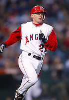 David Eckstein of the Los Angeles Angels runs the bases during a 2002 MLB season game at Angel Stadium, in Anaheim, California. (Larry Goren/Four Seam Images)