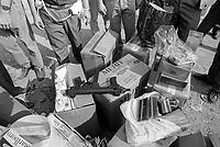 - Milano, Luglio1991, sigarette di contrabbando ed altro materiale sequestrato dalla polizia nell'accampamento abusivo di immigrati nordafricani a Molino Dorino, periferia nord della città<br /> <br /> - Milan, July 1991, smuggled cigarettes and other material seized by the police in the abusive camp of North African immigrants in Molino Dorino, a northern suburb of the city