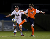 Connor Klekota (3) of Notre Dame fights for the ball with Ryan Zinkhan (21) of Virginia during the ACC tournament semifinals at the Maryland SoccerPlex in Boyds, MD.  Virginia advanced to the finals after tying Notre Dame, 3-3, in overtime and then defeating them on penalty kicks.