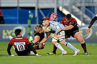 20130127 Copyright onEdition 2013©.Free for editorial use image, please credit: onEdition..Luke Hamilton of Cardiff Blues is wrapped up by Nick Fenton-Wells (centre) and John Smit of Saracens during the LV= Cup match between Saracens and Cardiff Blues at Allianz Park on Sunday 27th January 2013 (Photo by Rob Munro)..For press contacts contact: Sam Feasey at brandRapport on M: +44 (0)7717 757114 E: SFeasey@brand-rapport.com..If you require a higher resolution image or you have any other onEdition photographic enquiries, please contact onEdition on 0845 900 2 900 or email info@onEdition.com.This image is copyright onEdition 2013©..This image has been supplied by onEdition and must be credited onEdition. The author is asserting his full Moral rights in relation to the publication of this image. Rights for onward transmission of any image or file is not granted or implied. Changing or deleting Copyright information is illegal as specified in the Copyright, Design and Patents Act 1988. If you are in any way unsure of your right to publish this image please contact onEdition on 0845 900 2 900 or email info@onEdition.com