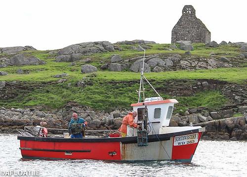An inshore fishing vessel at Dalkey Island on Dublin Bay