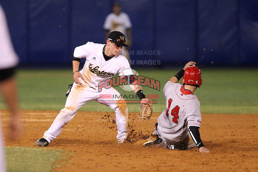 Western Michigan Broncos second baseman Dan Shutes #33 attempts to tag Bryan Huff #14 sliding in during a game against the Illinois State Redbirds at Chain of Lakes Stadium on March 10, 2012 in Winter Haven, Florida.  Illinois State defeated Western Michigan 10-9.  (Mike Janes/Four Seam Images)