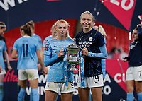 1st November 2020; Wembley Stadium, London, England; Womens FA Cup Final Football, Everton Womens versus Manchester City Womens; Chloe Kelly and Esme Morgan of Manchester City Women pose with the Womens FA Cup Final Trophy