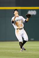 Charlotte Knights shortstop Tyler Saladino (8) settles under a fly ball in shallow left field during the game against the Rochester Red Wings at BB&T Ballpark on June 5, 2014 in Charlotte, North Carolina.  The Knights defeated the Red Wings 7-6.  (Brian Westerholt/Four Seam Images)