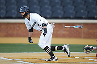 Patrick Frick (5) of the Wake Forest Demon Deacons tosses his bat as he starts down the first base line during the game against the Sacred Heart Pioneers at David F. Couch Ballpark on February 15, 2019 in  Winston-Salem, North Carolina.  The Demon Deacons defeated the Pioneers 14-1. (Brian Westerholt/Four Seam Images)
