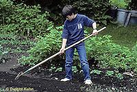 HB03-135x  Boy raking soil over just planted seeds