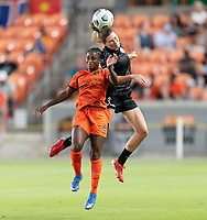 HOUSTON, TX - SEPTEMBER 10: Arin Wright #3 of the Chicago Red Stars heads the ball over Nichelle Prince #8 of the Houston Dash during a game between Chicago Red Stars and Houston Dash at BBVA Stadium on September 10, 2021 in Houston, Texas.