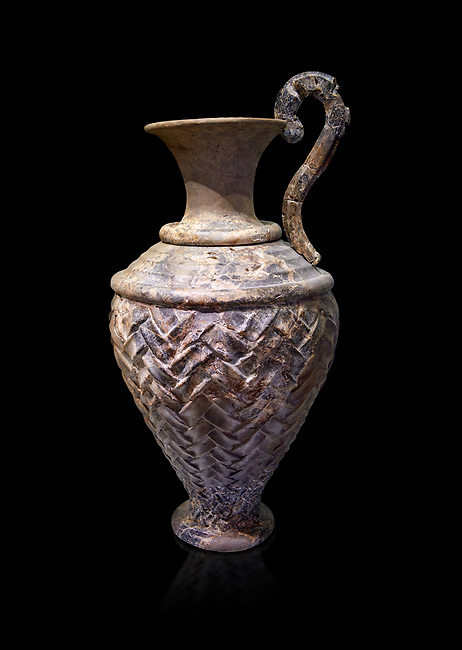Minoan stone ewer jug  with relief pattern from the  Knossos  Palace 1600-1450 BC, Heraklion Archaeological  Museum, black background.