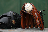 June 13th 2008:  A Nike glove belonging to Jarrod Parker of the South Bend Silver Hawks, Class-A affiliate of the Arizona Diamondbacks, sits on the bench next to a teammates Rawlings glove before a game at Stanley Coveleski Regional Stadium in South Bend, IN.  Photo by:  Mike Janes/Four Seam Images