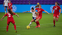 ORLANDO CITY, FL - FEBRUARY 18: Carli Lloyd #10 tries to cut inside of Shelina Zadorsky #4 during a game between Canada and USWNT at Exploria stadium on February 18, 2021 in Orlando City, Florida.