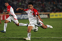 Costa Rica's Diego Madrigal (11) makes a kick against Egypt during the FIFA Under 20 World Cup Round of 16 match between Egypt and Costa Rica at the Cairo International Stadium on October 06, 2009 in Cairo, Egypt.