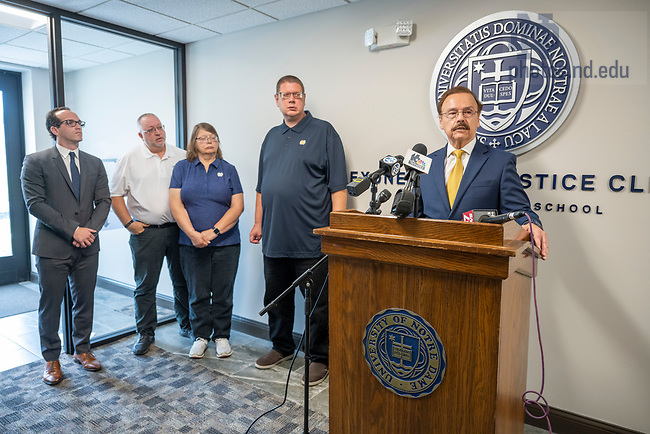July 21, 2021; Notre Dame Professor of Law, Jimmy Gurule speaks at a press conference to announce the exoneration of Andrew Royer (on his right) at the Exoneration Justice Clinic in South Bend. Accompanying Royer is his mother Jeannie and stepfather Mike Pennington along with attorney Elliot Slosar (left). Royer is the clinic's first exoneree. His murder charge from 2002 was dismissed this week.  (Photo by Barbara Johnston/University of Notre Dame)