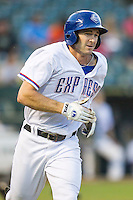 Round Rock Express outfielder Jared Hoying (30) runs to first base during the Pacific Coast League baseball game against the Fresno Grizzlies on June 22, 2014 at the Dell Diamond in Round Rock, Texas. The Express defeated the Grizzlies 2-1. (Andrew Woolley/Four Seam Images)