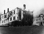 On April 8, 1935, a fire destroyed the Middlebury Town Hall and Congregational Church. This view is from the rear while the blaze was in progress. the town hall is in the foreground and the church is on the right.