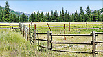 Eight Mile Ranch along the Chewuch River, near Falls Creek Campground.  Often used to stage fire camps in summer, this ranch becomes Eight Mile Sno-Park in winter.  The Chewuch is a tribuary of the Methow River.  Near Winthrop, Washington.