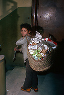 Child garbage collector in Cairo, Egypt - Child labor as seen around the world between 1979 and 1980 - Photographer Jean Pierre Laffont, touched by the suffering of child workers, chronicled their plight in 12 countries over the course of one year.  Laffont was awarded The World Press Award and Madeline Ross Award among many others for his work.