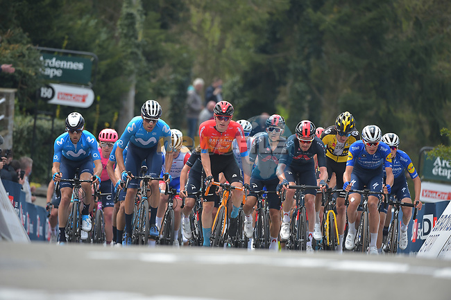 The peloton climb the Mur de Huy during the 2021 Flèche-Wallonne, running 193.6km from Charleroi to Huy, Belgium. 21st April 2021.  <br /> Picture: Serge Waldbillig | Cyclefile<br /> <br /> All photos usage must carry mandatory copyright credit (© Cyclefile | Serge Waldbillig)