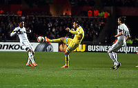 Swansea, UK. Thursday 20 February 2014<br /> Pictured: Goran Pandev of Napoli (C) against Jonathan de Guzman (L) and Chico Flores (R) attempts to cross the ball<br /> Re: UEFA Europa League, Swansea City FC v SSC Napoli at the Liberty Stadium, south Wales, UK