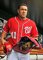 22 July 2012: Washington Nationals catcher Sandy Leon prepares for a game against the Atlanta Braves at Nationals Park in Washington, DC. The Nationals defeated the Braves 9-2 to split their 4-game weekend series. Mandatory Credit: Ed Wolfstein Photo