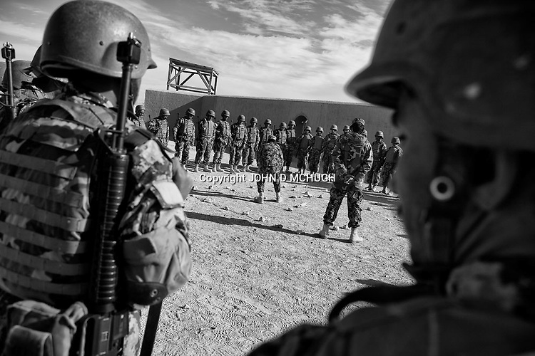 Afghan National Army soldiers take part in Military Operations in Urban Terrain (MOUT) training at the Regional Training Centre in Helmand, 17 Nov 2012. (John D McHugh)